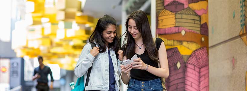 Two students looking at mobile content