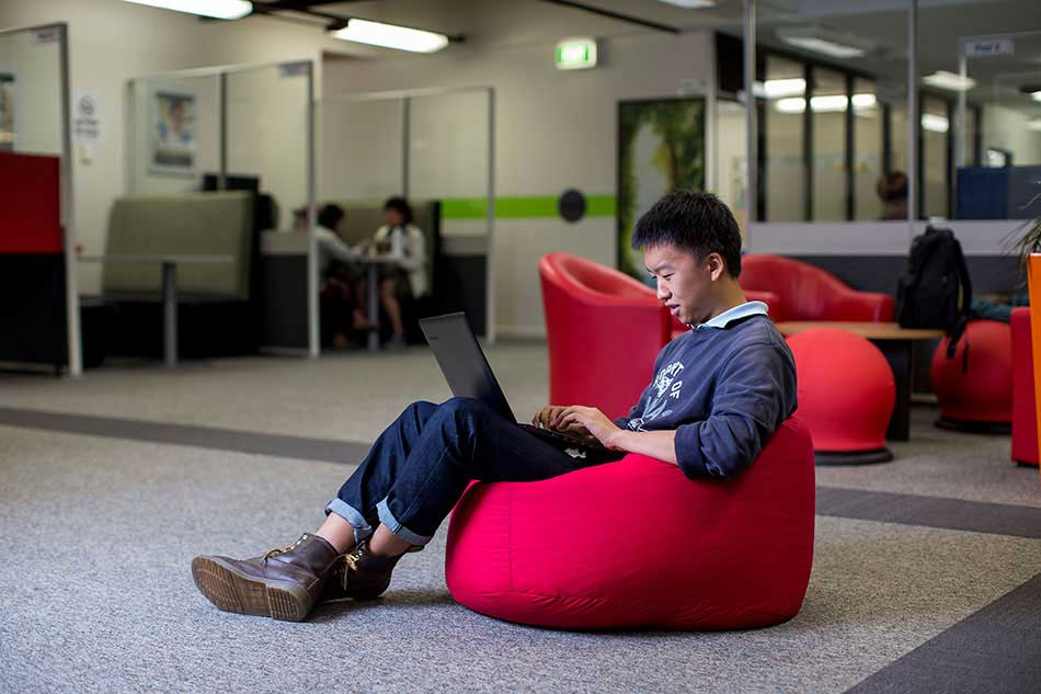 Student studying on a comfy chair at UWA