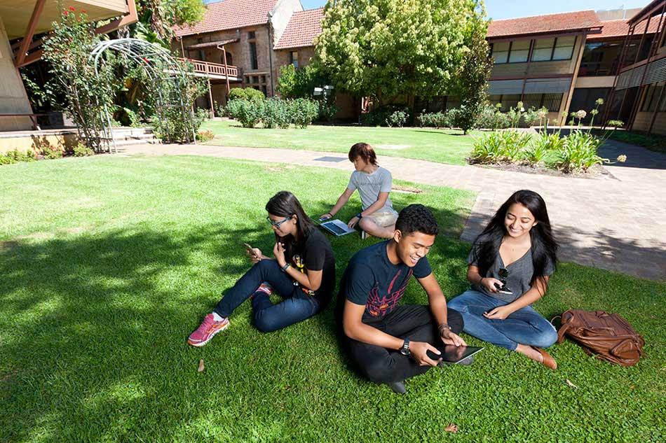 UWA students relaxing in campus gardens